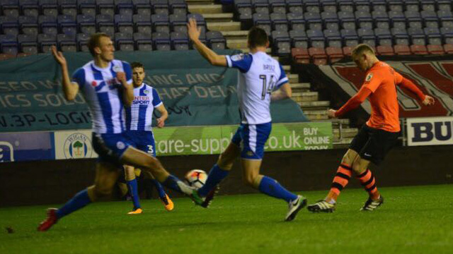 AFC Fylde suffered late heartbreak in their FA Cup second round replay against Wigan Athletic at the DW Stadium.        Danny Rowe put the Coasters ahead midway through the second-half after Simon Grand had cancelled out Ivan ToneyÂ's opener, however Wigan substitute Will Grigg struck twice in the...